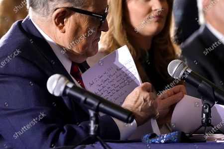 Former Mayor of New York Rudy Giuliani, a lawyer for President Donald Trump, notes are visible after he spoke at a hearing of the Pennsylvania State Senate Majority Policy Committee, in Gettysburg, Pa