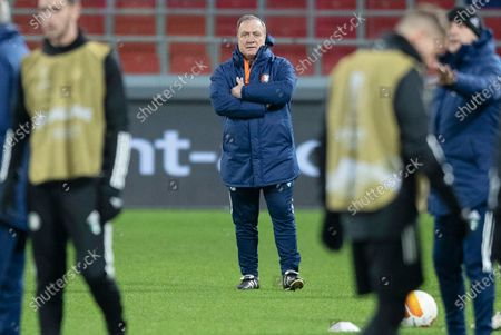 Feyenoord's head coach Dick Advocaat, center, attends a training session on the eve of the Europa League Group K soccer match between CSKA Moscow and Feyenoord at CSKA Arena in Moscow, Russia