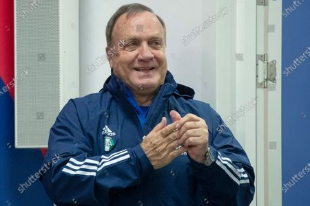 Feyenoord's head coach Dick Advocaat uses hand sanitizer to protect against coronavirus before a news conference on the eve of the Europa League Group K soccer match between CSKA Moscow and Feyenoord at CSKA Arena in Moscow, Russia
