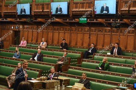 A handout photo made available by the UK Parliament shows Labour leader Keir Starmer during Prime Minister's Questions at the House of Commons at Parliament in London, Britain, 25 November 2020.