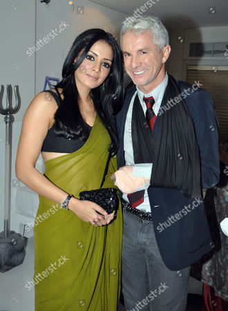 Celina Jaitley with Baz Luhrmann, sporting a sling recently acquired since his arrival in Mumbai