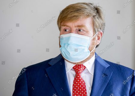 Dutch King Willem-Alexander visits care organization Thebes and rehabilitation clinic De MARQ in Breda, Netherlands, 25 November 2020. The king is given an explanation of the protective measures for the nursing staff and for the visitors of the patients.