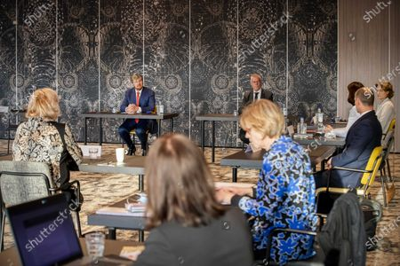 Dutch King Willem-Alexander (rear-L) visits care organization Thebes and rehabilitation clinic De MARQ in Breda, Netherlands, 25 November 2020. The king is given an explanation of the protective measures for the nursing staff and for the visitors of the patients.