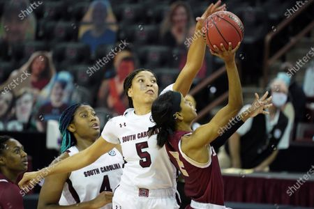 South Carolina forward Victaria Saxton (5) blocks a shot by Charleston guard Taylor Williams (2) during the second half of an NCAA college basketball game, in Columbia, S.C. South Carolina won 119-38