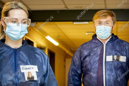 King Willem-Alexander during a visit to the isolated corona department of care organization Thebes in Breda, The Netherlands, 25 November 2020. The king is given an explanation of the protective measures for the nursing staff and for the visitors of the patients.