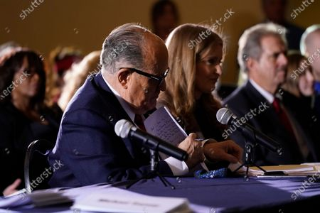 Rudy Giuliani's notes are visible after he spoke at a hearing of the Pennsylvania State Senate Majority Policy Committee, in Gettysburg, Pa