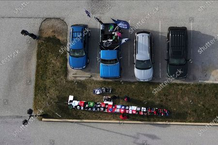 Stock Image of Table selling President Donald Trump paraphernalia is seen in the parking lot of the Wyndham Hotel, where Rudy Giuliani, an attorney for the president, is speaking at a hearing of the Pennsylvania State Senate Majority Policy Committee, in Gettysburg, Pa