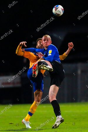 Stock Image of James Perch of Mansfield Town and Mark Beck of Harrogate Town fight for possession