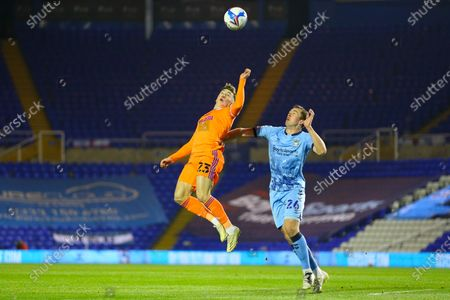 Cardiff City's Harry Wilson and Jordan Shipley of Coventry City compete for a high ball