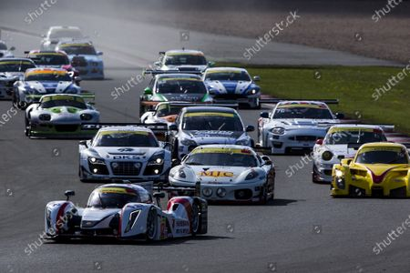 2015 Silverstone Dunlop Britcar 24 Hour. Silverstone, Northamptonshire. 24th - 26th April 2015. Start. #12 - Lawrence Tomlinson (GB)/Mike Simpson (GB)/Sir Chris Hoy (SCO)/Charlie Robertson (GB)/Caetan Paletou - Team LNT, LMP3, Ginetta LMP3, leads #10 - Laurence Wiltshire (GB)/Chanin Nouri (SW)/Martyn Smith (GB)/Richard Roberts (GB) - Radical Sportscars, LMPX, Radical RXC V8, #10 - Laurence Wiltshire (GB)/Chanin Nouri (SW)/Martyn Smith (GB)/Richard Roberts (GB) - Radical Sportscars, LMPX, Radical RXC V8, #4 - Witt Gamski (GB)/Phil Dryburgh (SCO)/Joe Macari (GB)/Rory Butcher (SCO) - MJC, GT2, Ferrari 430 GT2 and #8 - Sam Mowle/Frank Pelle/Peter Cook/Adam Sharpe - Colin Mowle, Audi R8 on the opening lap.  World Copyright: Zak Mauger/LAT Photographic.