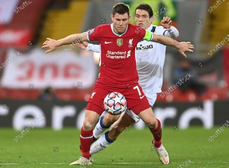 Liverpool's James Milner shields the ball from Atalanta's Marten de Roon, right, during the Champions League group D soccer match between Liverpool and Atalanta at Anfield stadium in Liverpool, England