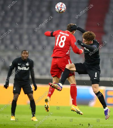 Salzburg's Mergim Berisha, right, challenges Bayern's Leon Goretzka, center, during the Champions League Group A soccer match between Bayern Munich and RB Salzburg at the Allianz Arena in Munich, Czech Republic