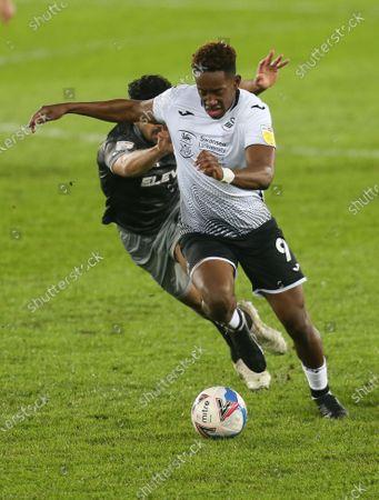 Jamal Lowe of Swansea City gets away from Massimo Luongo of Sheffield Wednesday