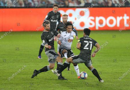 Yan Dhanda of Swansea City takes on Julian Borner of Sheffield Wednesday and Massimo Luongo of Sheffield Wednesday