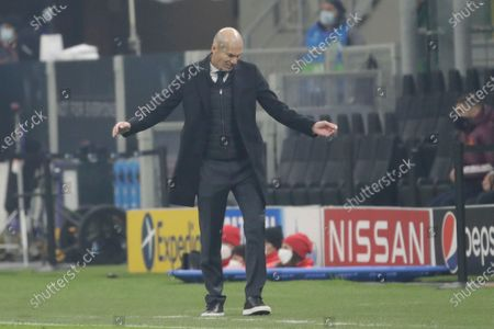 Real Madrid's head coach Zinedine Zidane gestures during the Group B, Champions League soccer match between Inter Milan and Real Madrid at the San Siro Stadium, in Milan, Italy