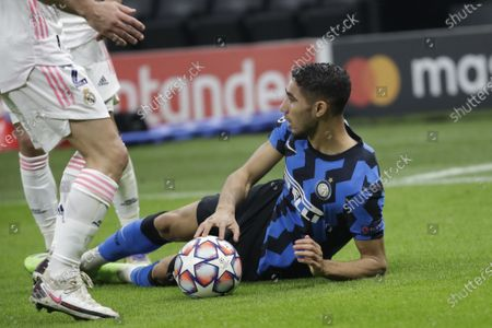 Inter Milan's Achraf Hakimi lies on the pitch during the Group B, Champions League soccer match between Inter Milan and Real Madrid at the San Siro Stadium, in Milan, Italy
