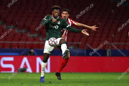Atletico Madrid's Stefan Savic (R) in action against Lokomotiv Moscow's Ze Luis (L) during the UEFA Champions League group A soccer match between Atletico Madrid and Lokomotiv Moscow at Metropolitano stadium in Madrid, Spain, 25 November 2020.