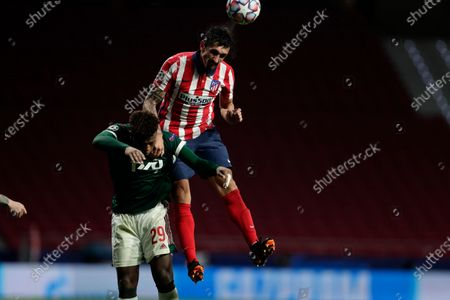 Atletico Madrid's Stefan Savic heads the ball during the Champions League group A soccer match between Atletico Madrid and Lokomotiv Moscow at the Wanda Metropolitano stadium in Madrid, Spain