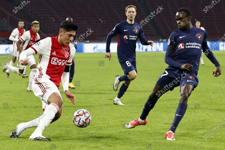 (l to r) Edson Alvarez of Ajax, Pione Sisto or FC Midtjylland during the UEFA Champions League Group D match between Ajax Amsterdam and FC Midtjylland at the Johan Cruijff Arena in Amsterdan, Netherlands, 25 November 2020.