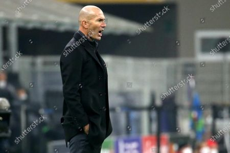 Real Madrid's coach Zinedine Zidane reacts   during the UEFA Champions League Group B soccer match between Inter and Real Madrid at Giuseppe Meazza stadium in Milan, Italy, 25 November 2020.