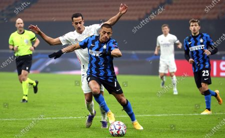 Stock Picture of Real Madrid's Lucas Vazquez (L) challenges for the ball with Inter Milan's Alexis Sanchez during the UEFA Champions League Group B soccer match between Inter and Real Madrid at Giuseppe Meazza stadium in Milan, Italy, 25 November 2020.