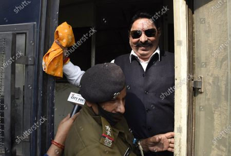 RJD MLA Anant Singh being deatined by a police official at Bihar Assembly on November 25, 2020 in Patna, India.