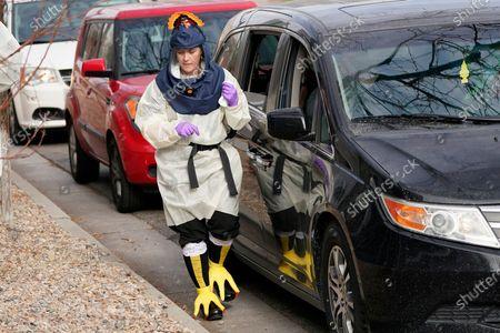 Salt Lake County Health Department public health nurse Lee Cherie Booth administers coronavirus tests dressed as a turkey outside the Salt Lake County Health Department, in Salt Lake City