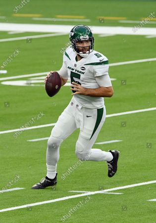 New York Jets quarterback Joe Flacco (5) scrambles with the ball during an NFL football game against the Los Angeles Chargers, in Inglewood, Calif. The Chargers defeated the Jets 34-28