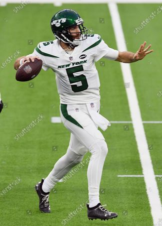 New York Jets quarterback Joe Flacco (5) throws a pass on the run during an NFL football game against the Los Angeles Chargers, in Inglewood, Calif. The Chargers defeated the Jets 34-28