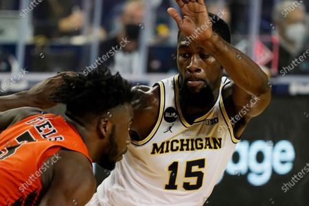 Michigan guard Chaundee Brown (15) guards Bowling Green guard Caleb Fields (3) as Fields goes up court during the second half of an NCAA college basketball game, in Ann Arbor, Mich