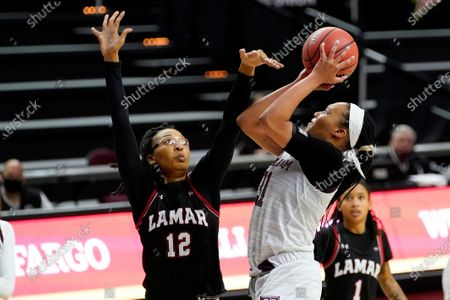 Texas A&M forward N'Dea Jones (31) gets a shot past Lamar forward Micaela Wilson (12) during the second half of an NCAA college basketball game, in College Station, Texas