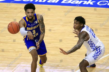 Stock Picture of Morehead State's James Baker, left, passes the ball away from Kentucky's Cam'Ron Fletcher during the first half of an NCAA college basketball game in Lexington, Ky