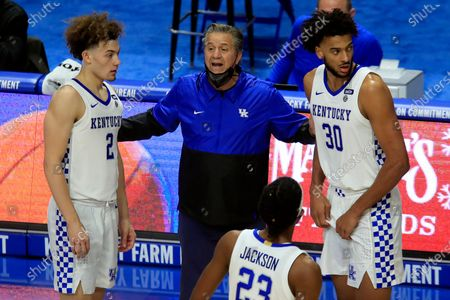 Stock Picture of Kentucky coach John Calipari, center, talks to Devin Askew (2), Olivier Sarr (30) and Isaiah Jackson (23) during the second half of the team's NCAA college basketball game against Morehead State in Lexington, Ky
