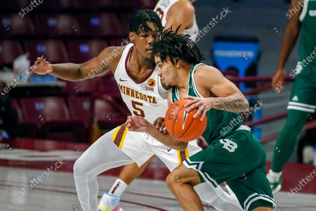 Stock Image of Minnesota guard Marcus Carr (5) defends against Green Bay guard Jacob Jones (11) in the first half of an NCAA college basketball game, in Minneapolis. Minnesota won 99-69