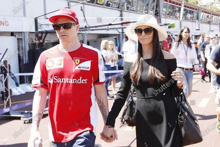 "Stock Image of Monte Carlo, Monaco. Friday 22 May 2015. Kimi Raikkonen, Ferrari, and girlfriend Minna-Mari ""Minttu"" Virtanen in the pit lane. World Copyright: Alastair Staley/LAT Photographic."