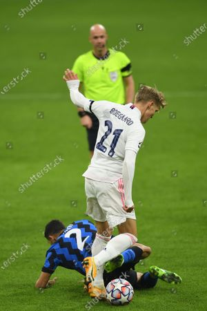 Martin Odegaard (Real Madrid) Achraf Hakimi (Inter) during the Uefa Champions League match between Inter 0-2 Real Madrid at Giuseppe Meazza Stadium in Milano, Italy.