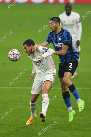 Eden Hazard (Real Madrid) Achraf Hakimi (Inter) during the Uefa Champions League match between Inter 0-2 Real Madrid at Giuseppe Meazza Stadium in Milano, Italy.