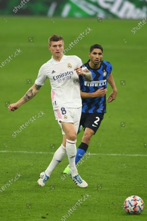 Toni Kroos (Real Madrid) Achraf Hakimi (Inter) during the Uefa Champions League match between Inter 0-2 Real Madrid at Giuseppe Meazza Stadium in Milano, Italy.