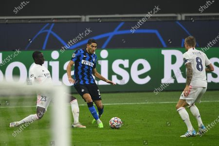 Stock Photo of Ferland Mendy (Real Madrid) Achraf Hakimi (Inter) Toni Kroos (Real Madrid) during the Uefa Champions League match between Inter 0-2 Real Madrid at Giuseppe Meazza Stadium in Milano, Italy.