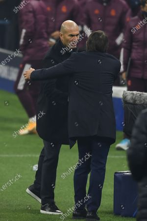 Zinedine Zidane (Real Madrid) Antonio Conte Coach (Inter) during the Uefa Champions League match between Inter 0-2 Real Madrid at Giuseppe Meazza Stadium in Milano, Italy.