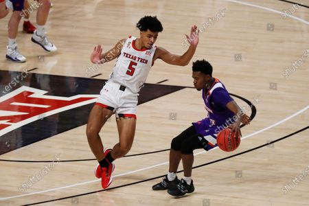 Texas Tech guard Micah Peavy defends against Northwestern State guard CJ Jones during the first half of an NCAA college basketball game, in Lubbock, Texas