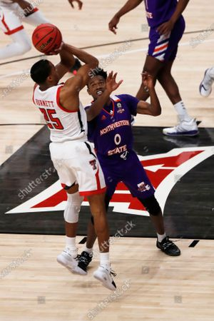 Texas Tech guard Nimari Burnett shoots guarded by Northwestern State guard CJ Jones during the first half of an NCAA college basketball game, in Lubbock, Texas