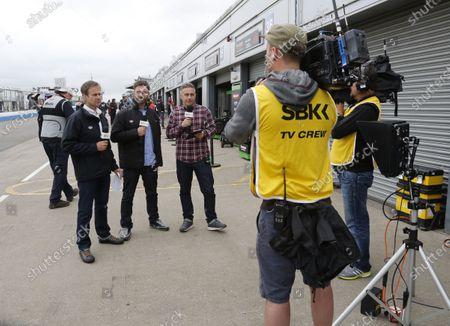 2015 World Superbike Championship.  Donington Park, UK.  23rd - 24th May 2015.  Eurosport tv crew and presenters James Whitham, James Haydon and Matt Roberts.  Ref: KW5_3430a. World copyright: Kevin Wood/LAT Photographic