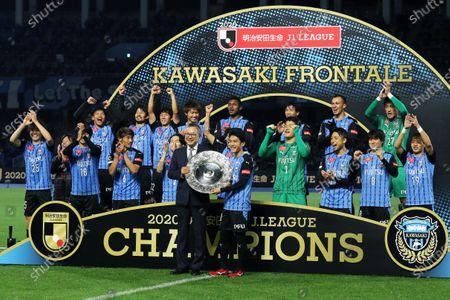 Stock Picture of Kawasaki Frontale team group - Football / Soccer : Kawasaki Frontale's Ryota Oshima receives the trophy from J League chairman Mitsuru Murai after winning the 2020 J1 League following a match between Kawasaki Frontale 5-0 Gamba Osaka at Kawasaki Todoroki Stadium in Kanagawa, Japan.