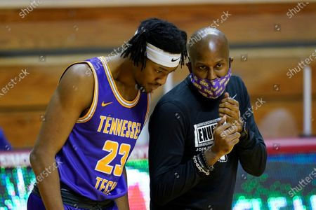 Stock Photo of Tennessee Tech assistant coach Marcus King talks with Austin Harvell (23) during the first half of the team's NCAA college basketball game against Indiana, in Bloomington, Ind