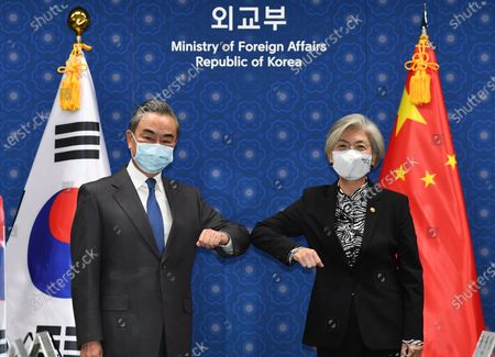 Chinese Foreign Minister Wang Yi (L) and South Korean Foreign Minister Kang Kyung-wha (R) bump elbows prior their meeting at the foreign ministry in Seoul, South Korea, 26 November 2020. Chinese Foreign Minister Wang Yi is in South Korea for a three-day state visit to discuss bilateral high-level exchanges, the situations on the Korean Peninsula and in the region.
