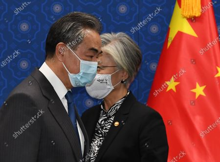 Chinese Foreign Minister Wang Yi (L) and South Korean Foreign Minister Kang Kyung-wha (R) arrive for their meeting at the foreign ministry in Seoul, South Korea, 26 November 2020. Chinese Foreign Minister Wang Yi is in South Korea for a three-day state visit to discuss bilateral high-level exchanges, the situations on the Korean Peninsula and in the region.