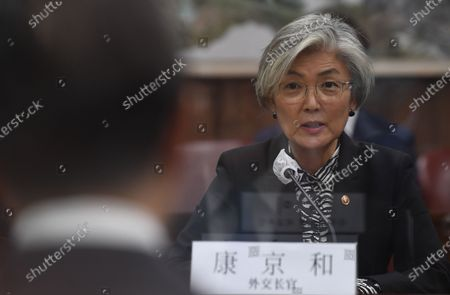 South Korean Foreign Minister Kang Kyung-wha (R) talks with Chinese Foreign Minister Wang Yi (L) during their meeting at the foreign ministry in Seoul, South Korea, 26 November 2020. Chinese Foreign Minister Wang Yi is in South Korea for a three-day state visit to discuss bilateral high-level exchanges, the situations on the Korean Peninsula and in the region.