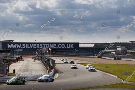 2015 Silverstone Dunlop Britcar 24 Hour. Silverstone, Northamptonshire. 24th - 26th April 2015. #34 - Alex Osbourne (GB)/James May (GB)/Paul May (GB) - APO Sport, GT4, Porsche 911 Cup Car leads #41 - Anthony Hughes/Ollie Hancock/Devon Modell - Speedworks Motorsport, GT4, Aston Martin Vantage.  World Copyright: Zak Mauger/LAT Photographic.