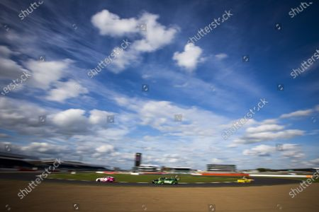 Stock Picture of 2015 Silverstone Dunlop Britcar 24 Hour. Silverstone, Northamptonshire. 24th - 26th April 2015. #59 - Ben Demetiou/Jonathan Evans/Alex Eacock/Paul Follet - CHF500, Porsche 968 and #34 - Alex Osbourne (GB)/James May (GB)/Paul May (GB) - APO Sport, GT4, Porsche 911 Cup Car.  World Copyright: Zak Mauger/LAT Photographic.